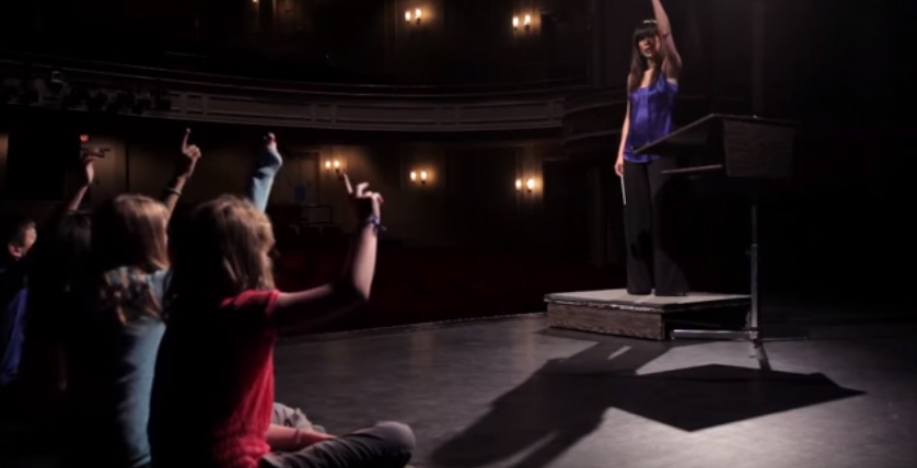 Children learn about conducting from Maestra Sarah Hicks (Screengrab from YouTube)